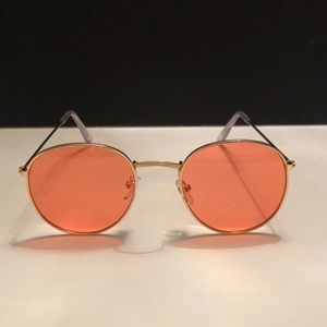 round pink peach lens- gold metal frame sunglasses
